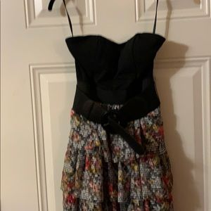 Strapless dress. Black top  Floral tiered skirt